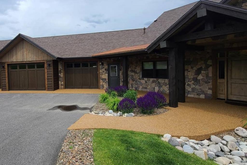 Pebble Stone epoxy Front porch and sidewalk with concrete resurfacing and Coastal Crete Service